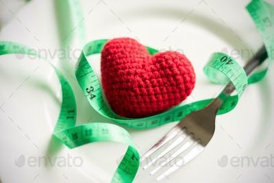 Red heart and healthy concept with measure tape