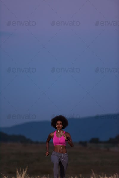 Young African american woman jogging in nature
