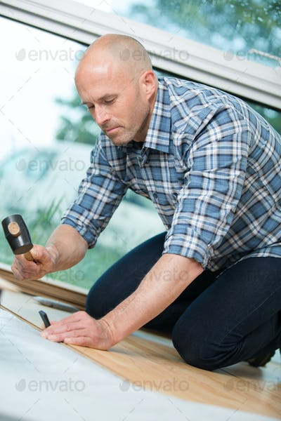 mand doing diy at his home