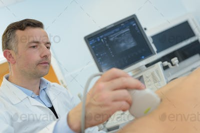 doctor doing ultrasound on pregnant woman in clinic