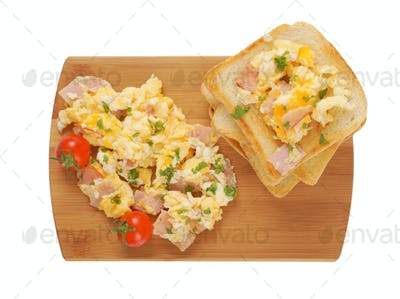 Scrambled eggs and toasted bread