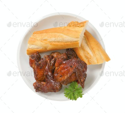 barbecue chicken wings with crispy baguette