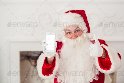 Santa Claus shows a smartphone on white background