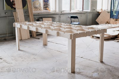 Table making in woodworking workshop.