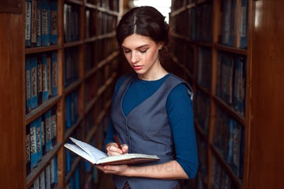 Woman reading in a library.