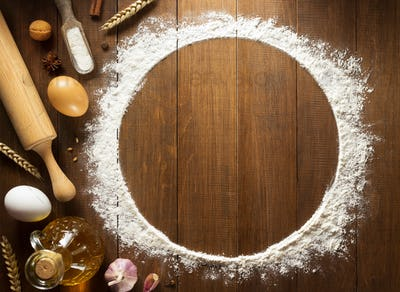 flour powder and  bakery ingredients on wood