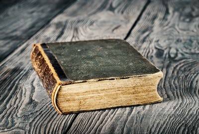 Ancient closed book with green cover
