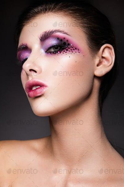 Beautiful woman with pink make up