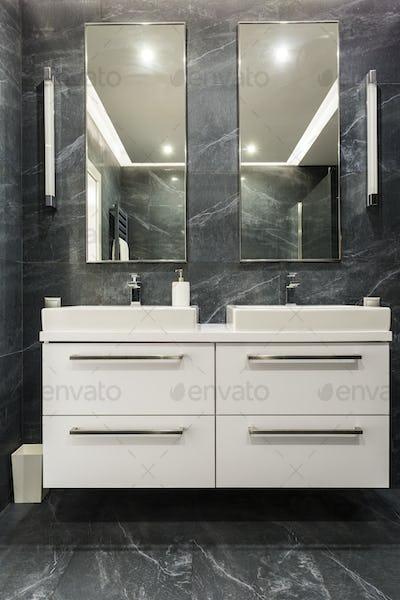 Dark granite bathroom with cabinet