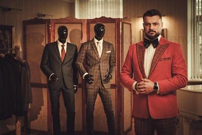 Extravagant stylish man in tailor studio