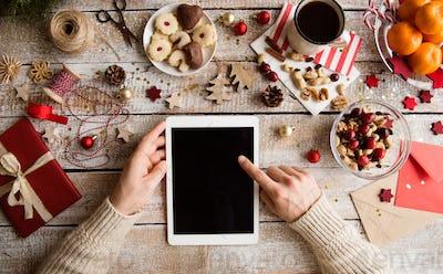 Christmas composition. Man holding tablet. Studio shot.