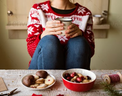 Unrecognizable woman with coffee cup, Christmas composition.