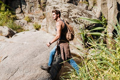 Side view of a man exploring wilderness on trekking adventure