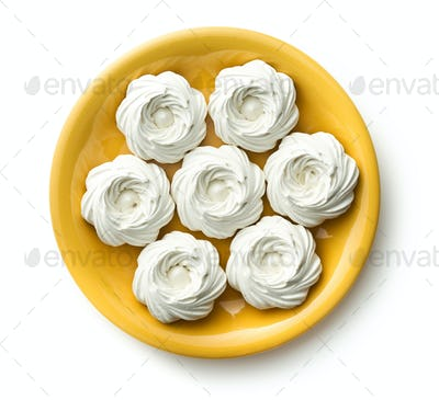 Sweet white meringue on plate.