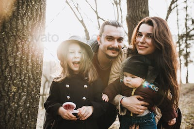 cheerful and happy family in autumn park