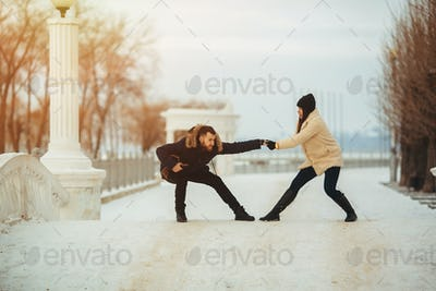 man and woman fooling around in park