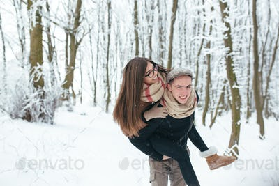 Happy couple playful together in snow park