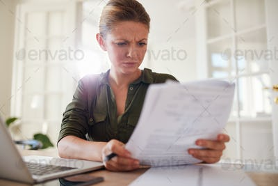 Woman busy working at home office