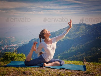 Sorty fit woman doing yoga asana outdoors in mountains