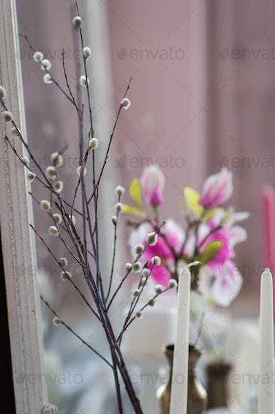 Shabby chic home design. Beautiful decoration table with a candles, flowers in front of a mirror