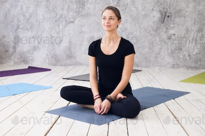 Woman practicing meditation at a yoga studio