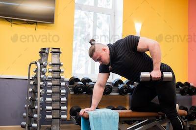 man pull up barbell fitness training