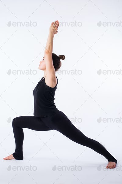 Young healthy woman practicing Balancing stick posture yoga on white background.