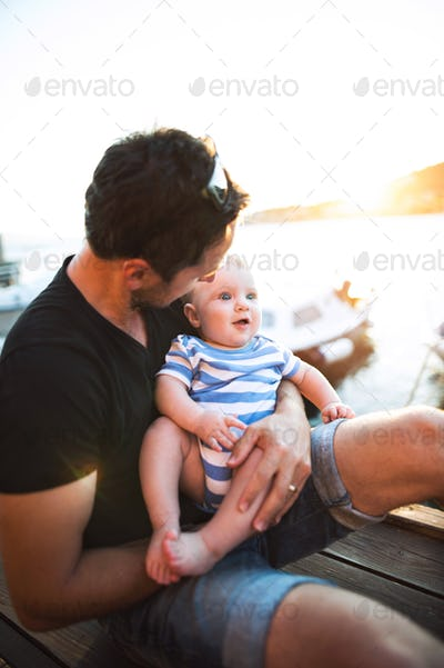 Man with baby son enjoying their time at seaside.