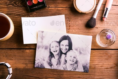 Mothers day composition. Family photo and beauty products.