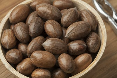 Bowl with whole pecan nuts