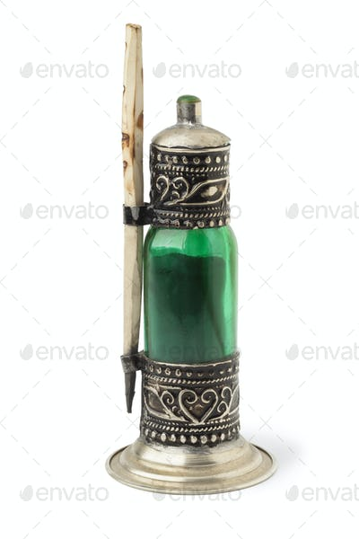 Moroccan green bottle with black kohl