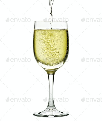 Champagne in glass. Isolated on white background
