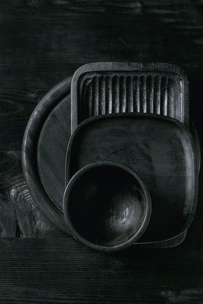 Black burnt wooden kitchenware