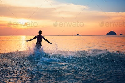 Man running into the sea
