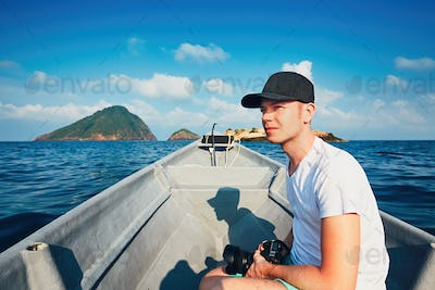 Photographer traveling by boat