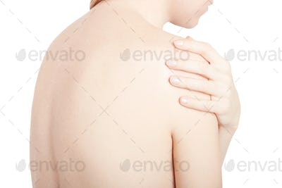 Young woman touching her painful shoulder isolated on white, cli