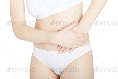Woman with lateral abdominal pain isolated on white, clipping pa