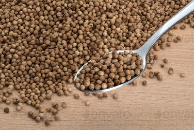 Coriander organic seeds on wooden cutting boards
