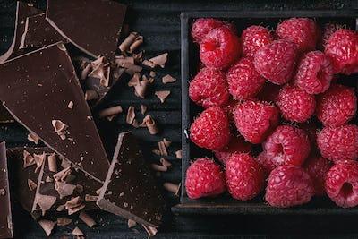 Variety of chopping chocolate with raspberries