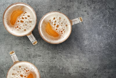 beer mugs on gray table