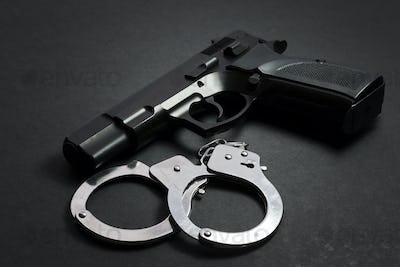 Handgun with handcuffs