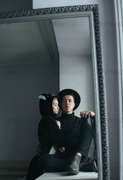 man and woman in black clothes