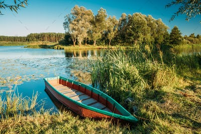 Lake Or River And Old Wooden Blue Rowing Fishing Boat At Beautif
