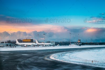 Aircraft stand at International Airport terminal in early mornin