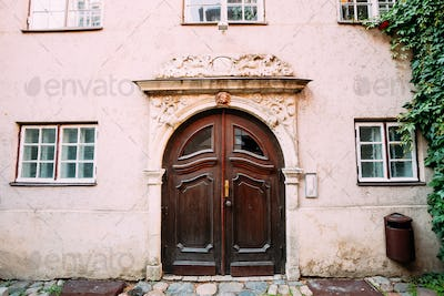 Riga Latvia. Wooden Door Of Portal Decorated By Molding On Facad