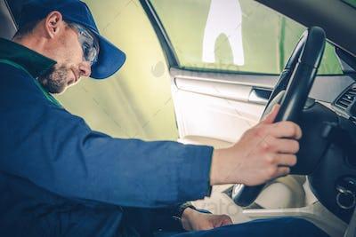 Car Mechanic Examining