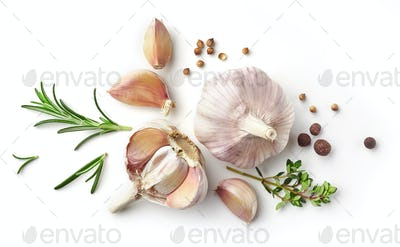 garlic and herbs on white background