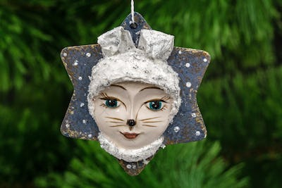 Festive decoration in the shape of a leveret mask, on a Christma