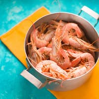 Casserole with shrimps on a bright yellow napkin