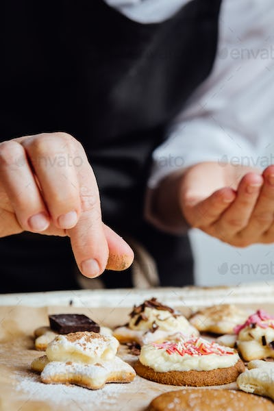 Person finishing homemade cookies